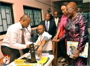 ● Permanent Secrerary, Federal Ministry of Health Mr Linus Awute gets his blood pressure checked in Abuja at the launch of the initiative