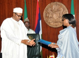 • WHO Regional Director for Africa, Dr Matshidiso Rebecca Moeti presenting the WHO certificate to President Buhari in Abuja.