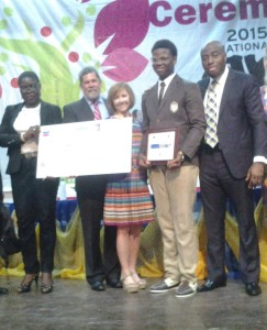 Overall winner, Ukaegbu Christopher (4th from left) flanked by (L-R) representative of the National Petroleum Investment Management Services (NAPIMS), CNL Director of Gas Mr. Steve Freeman, Wife of CNL CEO, Mrs Neff and the winner's teacher