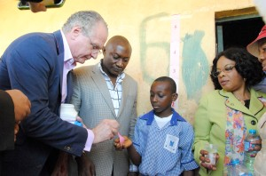 • (L-R) Merck CEO Dr Stefan Oschmann administers the drug on a student of LEA Primary School karon-majigi, watched keenly by one of the school teachers and Director public Health (FMOH) Dr Bridget Okoeguale. Health (FMOH) Dr Bridget Okoeguale during the handing over of drugs to the Federal Ministry of Health and children at Local Education at LEA School in Karon – majigi Abuja yesterday