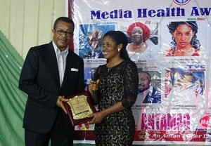 National Mirror Health Correspondent, Franka Osakwe receiving her award for the best newspaper health reporting.