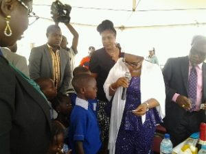 Mrs. Uzamat, representative of the First Lady of Lagos State, Mrs. Bolanle Ambode, de-worming a pupil at the launch of the Mass De-worming campaign in Lagos state Pix: Rebecca Ejiofor