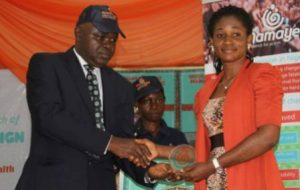 National Mirror Correspondent, Franka Osakwe, receiving her award.