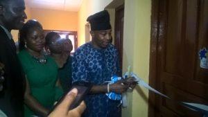 Hon. Olayinka Kazeem cutting the tape during the commissioning
