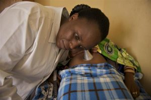 A female health work performs antenatal check up of a pregnant woman at a UNICEF supported MCH clinic (Maternal and Child) in the city of Musanze in northern Rwanda.