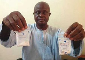Prof. Ezeibe displaying samples of his drug
